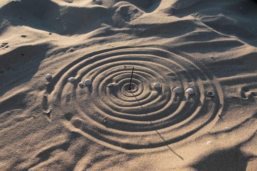 sundial on a beach