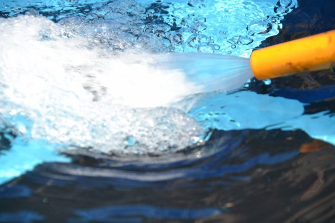 Image of a hose spraying water - paddling pool science for kids