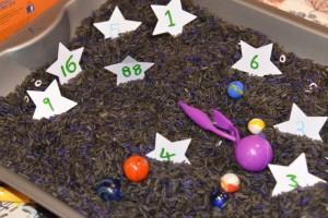 space themed sensory rice bin