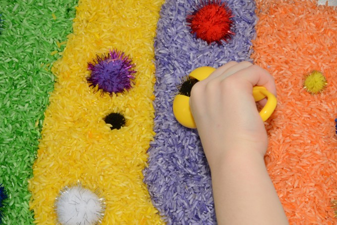 Willy Wonka Sensory tub made with coloured rice and pom poms