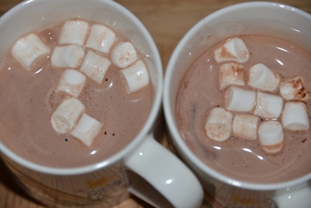 Hot chocolate science experiment with melting marshmallows