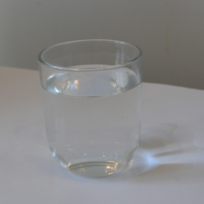 empty glass of water for a refraction of light experiment.