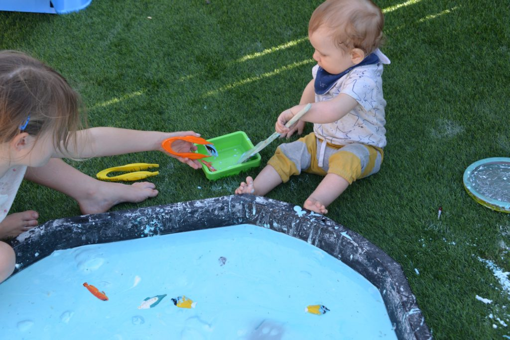 Giant oobleck tray - fishy themed sensory activity #sciencefortoddlers