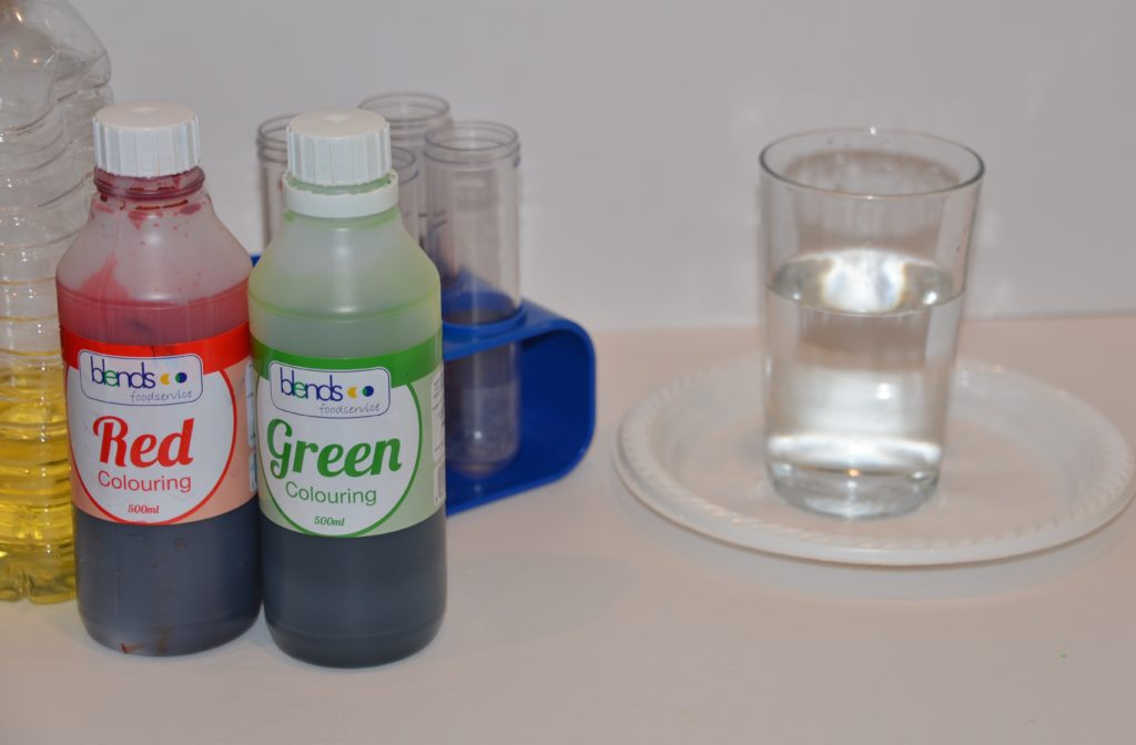 a glass of water and food colouring ready for a colourful water experiment