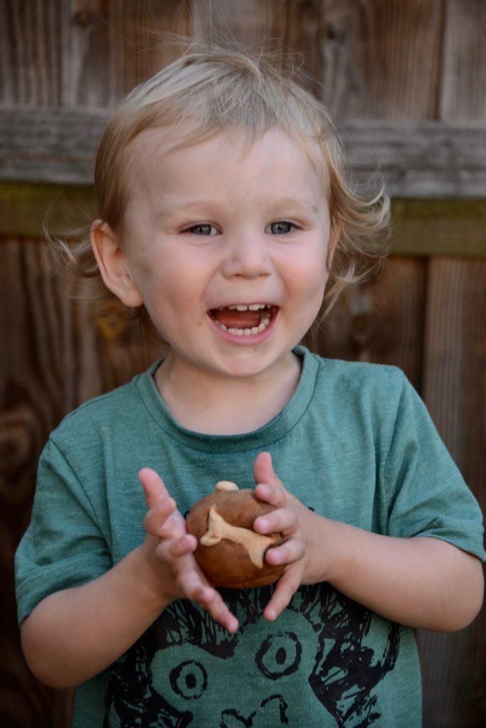 boy with dinosaur poop