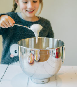 child making merginue to learn about kitchen science
