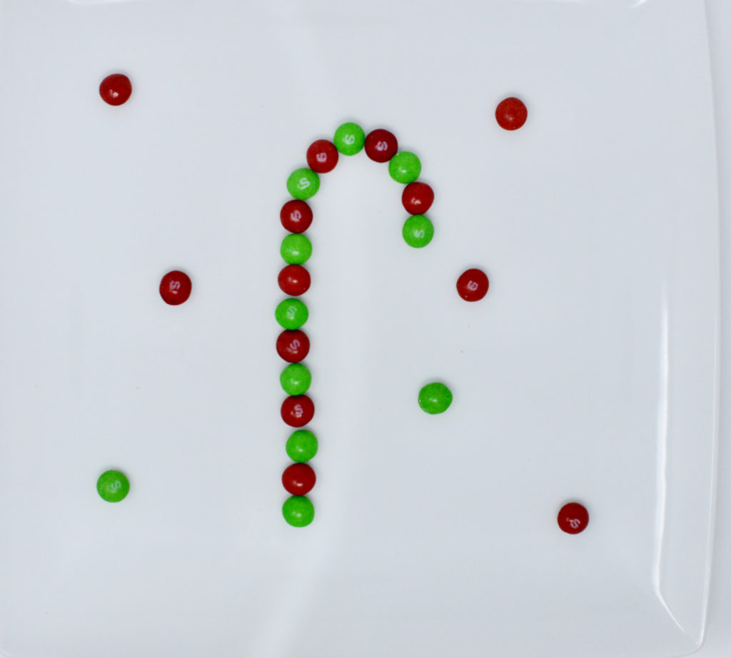 Christmas skittle candy experiment - skittles in the shape of a candy cane