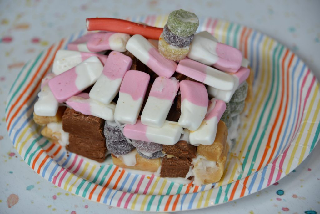A candy house made from sweets and chocolate for a science project or STEM challenge