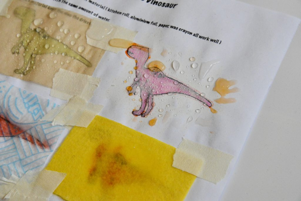 Image of dinosaurs on a sheet of paper covered with different materials for a waterproof activity
