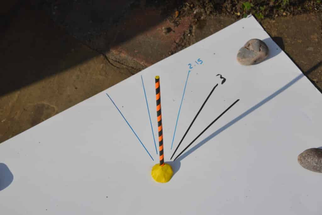 Simple sundial made with a straw and plasticine