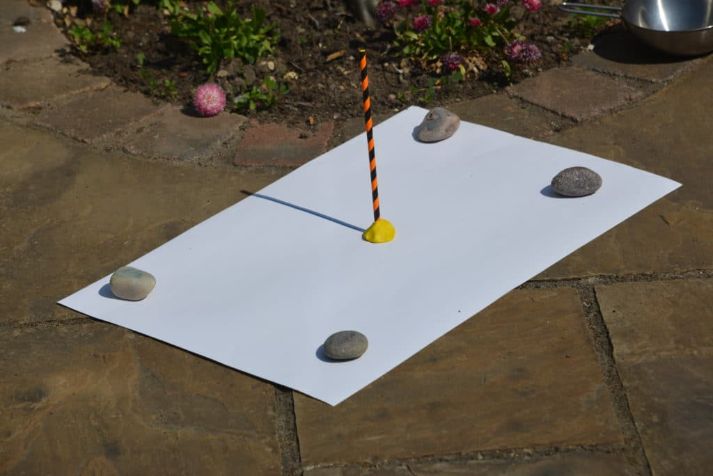 Sundial made with  a straw and plastcine