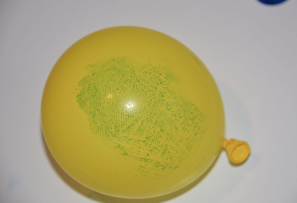 Balloon with a large fingerprint image - part of a fingerprint science project #scienceforkids