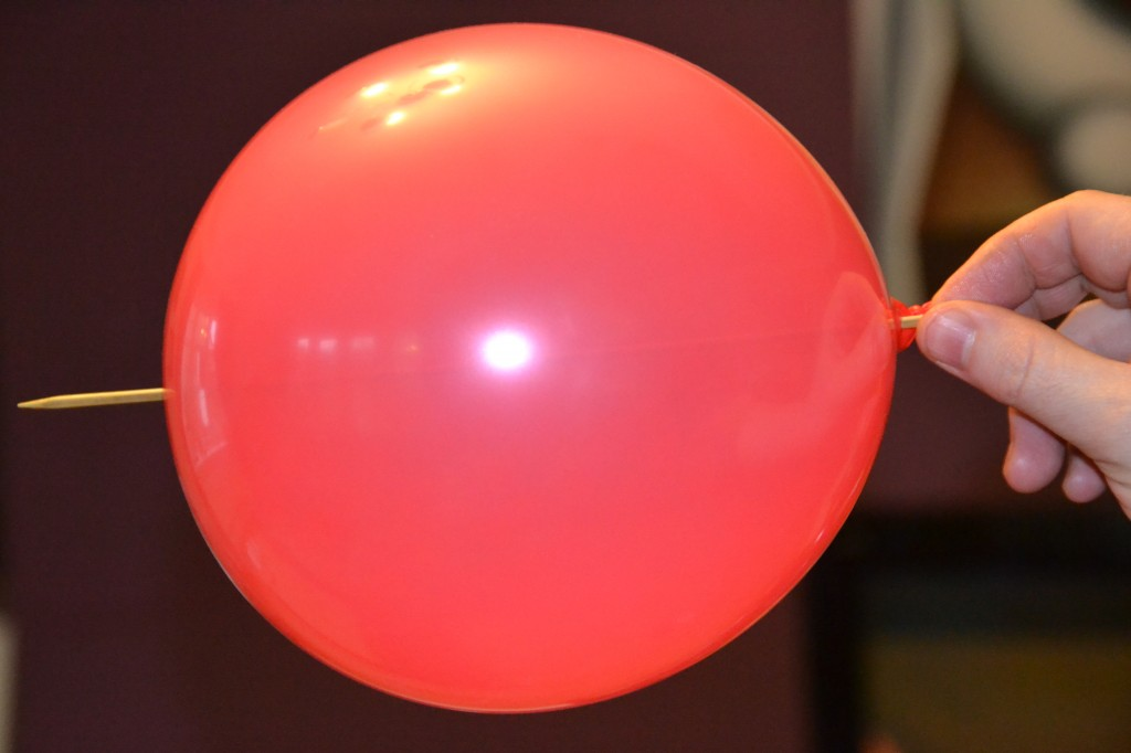 Skewer pushed through a balloon