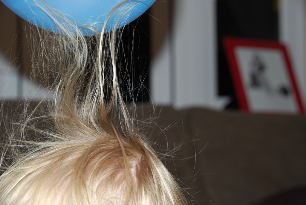 Childs hair sticking up because of static electricity