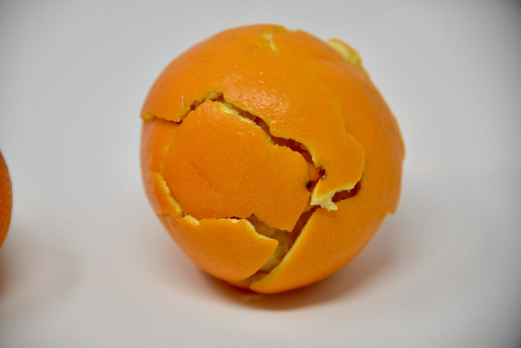 orange using peel to demonstrate plate tectonics