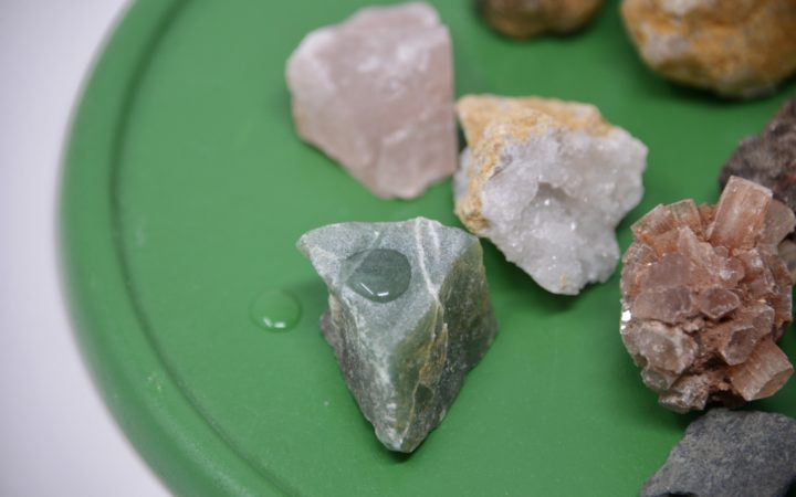 selection of rocks on a tray for a rock experiment for kids