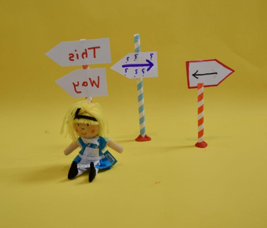 light refraction experiment, Alice in Wonderland themed.