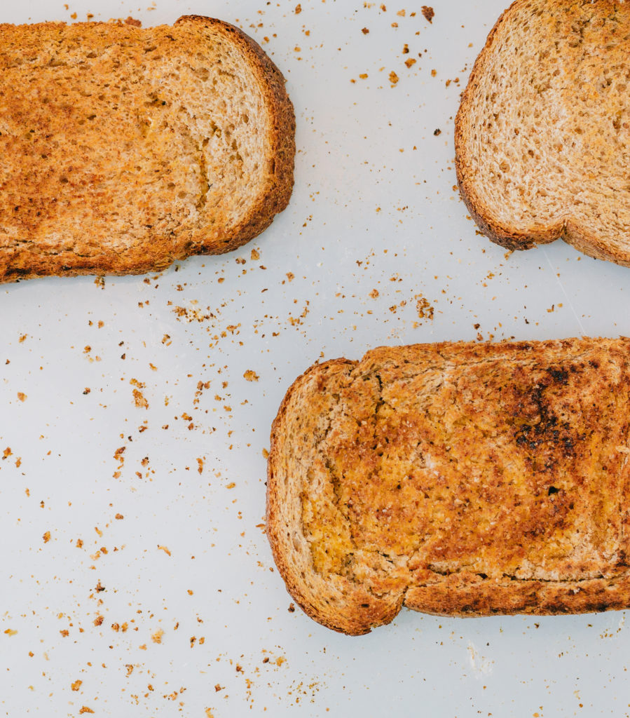 Buttered toast lying on the floor as part of a 'why does toast land butter side down' experiment