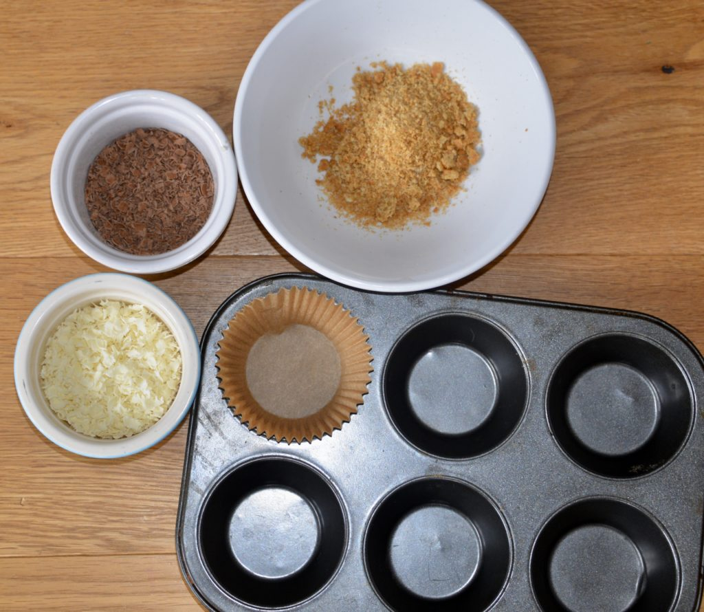 muffing tray with shaved choclates and crushed biscuits