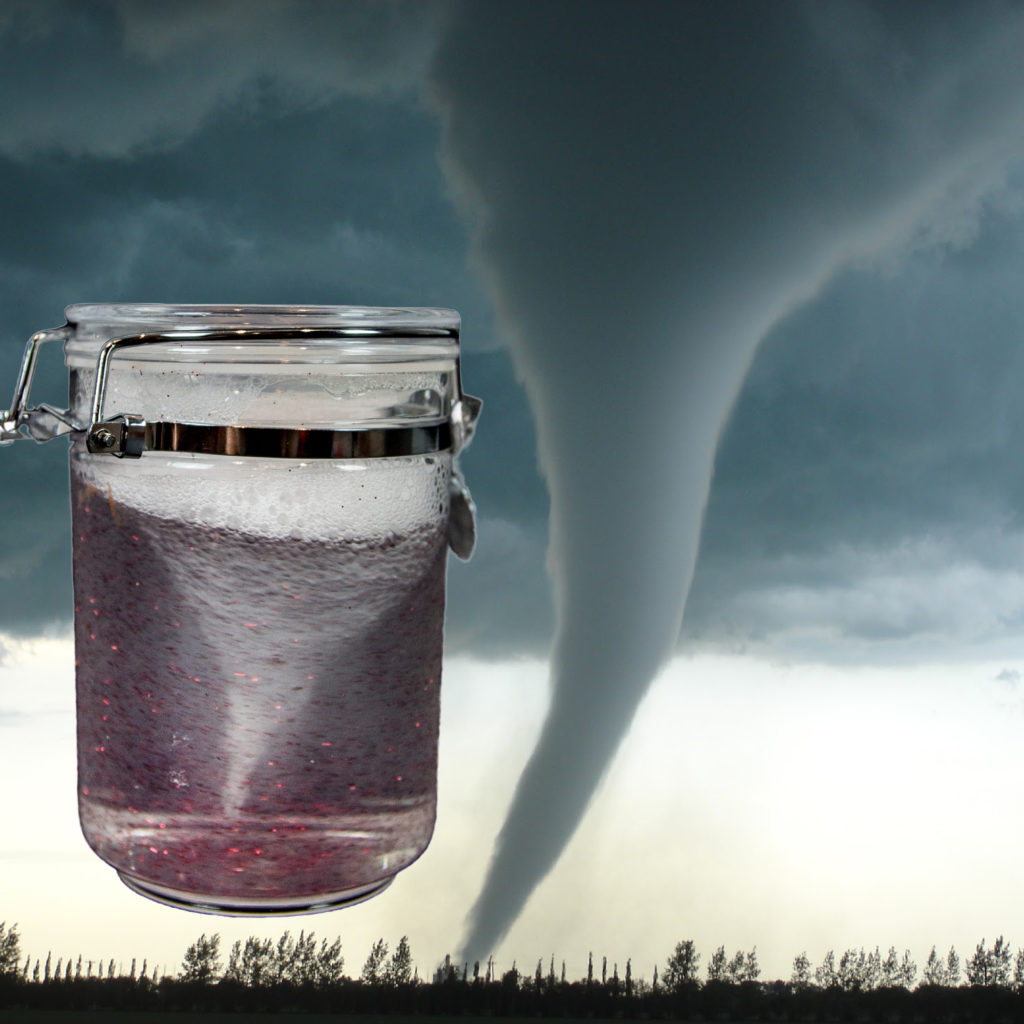 Image of a tornado in a jar made from water and dish soap swirling