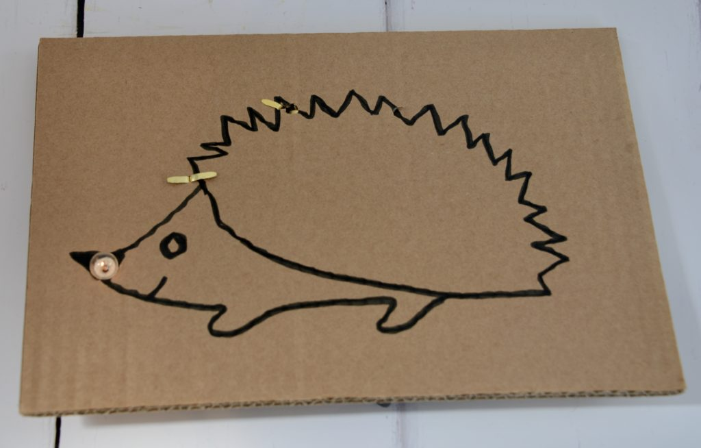 Image a of a hedgehog drawn on a sheet of cardboard for a fun cardboard STEM Challenge