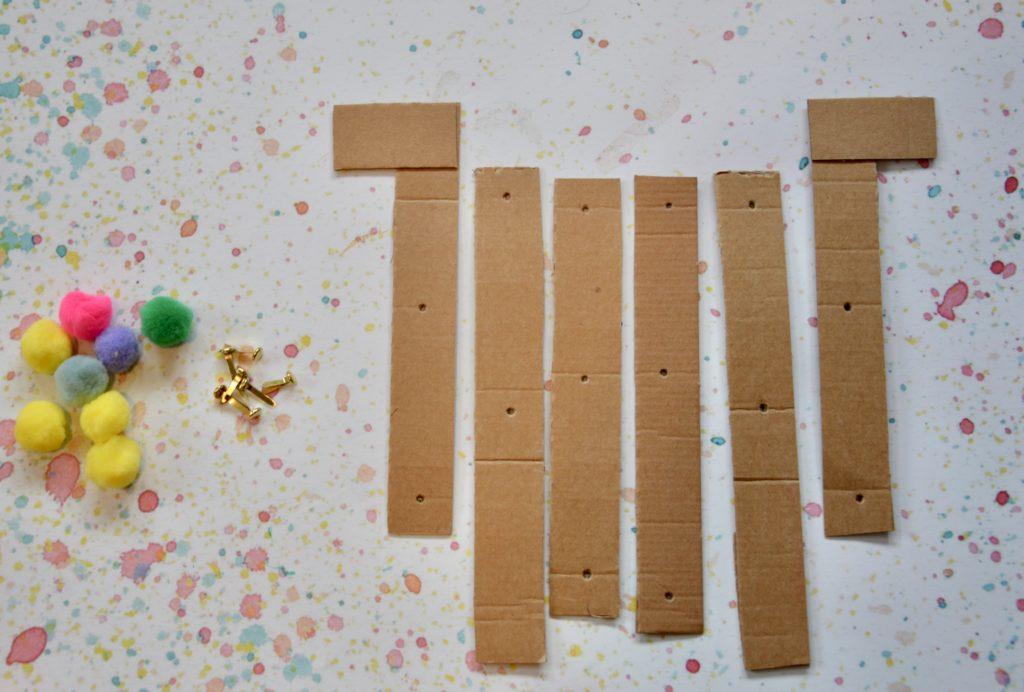 Articulated Grabber Materials - cardboard strips, pom poms and split pins